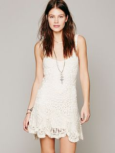 "Free People Radiance Crochet Dress For the best of the boho dreamers, this sleeveless crochet mini has a glittery thread running through. Soft slip included.  *72% Linen  *13% Nylon  *9% Acrylic  *4% Metallic  *2% Mohair  *Slip: 100% Viscose  *Import  In This Pic: Model's Height: 5' 8"" Wearing Size Small Measurements for Small: Bust: 30""= 76 cm  Waist: 27""= 69 cm  Length (from center bodice): 24 1/2""= 62 cm"