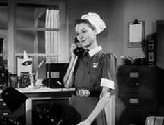 0 Janet Butler on the phone in the broken horseshoe  1953