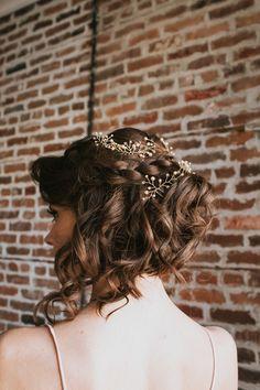 Braided wedding updo with gold wedding hair accessories
