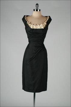 Love this!! Vintage 1950's Black Silk Shelf Bust Deadstock Wiggle Dress | From a collection of rare vintage evening dresses at http://www.1stdibs.com/fashion/clothing/evening-dresses/