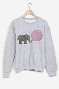 Heather grey sweatshirt hand-printed. American cut, crew neck, fitted shoulders and sleeves, ribbed trim and tightening at wrists. Ultra soft and comfortable inside.   Jumbo Bubble by Terry Fan for Rad.
