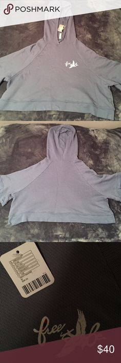 Free People Dance Hoddie Blue cropped short sleeve hoodie with a small fist size design of a bird with the words free to be👯 NWT Free People Tops Sweatshirts & Hoodies