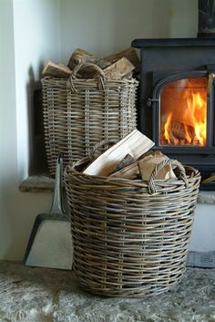 What a great way to keep firewood contained near the fireplace. Keeps everything clean and pretty.