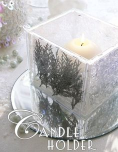 DIY Candle Holder made with clear cd cases and hot glue,you could put anything in the case ~ Think I would use a flameless candle. . .wouldn't want to take a chance of melting the cd cases. . .