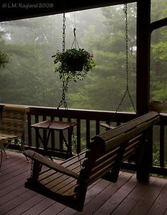 Imagine waking up in a cozy cabin in the mountains and walking out onto this porch with coffee in hand, inhaling the fresh smell of an early morning's rain