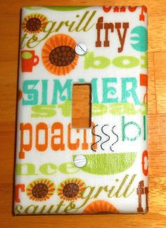 Fry, Grill, and Saute Kitchen Light Switch Plate Cover  (Matching Electrical Outlet Cover also available)  Handcrafted. No two are alike.  Positioning of Pattern may vary.  Easy to clean with a damp cloth.  Mounting screws included.