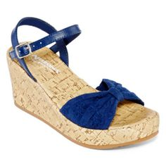 <p>Work a little sass into her casual look with our open-toe crochet sandals featuring a cool cork wedge.</p><p>