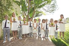 adorable ring bearers in ties and sneakers accompanied by precious flower girls... via Fancy That
