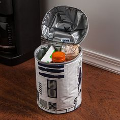 Go where no lunch has gone before . . . inside of an R2D2 lunch bag ($20) that makes beeps and boops at the push of a button and keeps food fresh with polyethylene foam insulation.