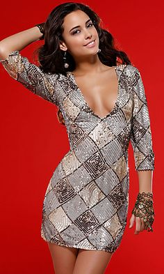 Show off your cleavage in this chic and sexy cocktail dress by Scala at homecoming, prom or special occasion. Glittering sequins in a bold geometric pattern create an eye stopping look for your next formal affair. This short party dress features a plunging v-neckline and three quarter sleeves on a slim fitting mini dress for a sexy and revealing look for prom or party.