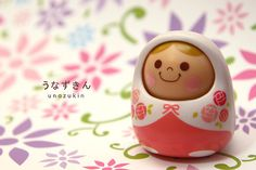 Unazukin toy listens to you talk, nodding and shaking her head. Similar appearance (probably inspired by) matryoshkas / Russian nesting dolls.