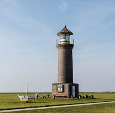 Juist Lighthouse (Memmertfeuer) at the port, Germany
