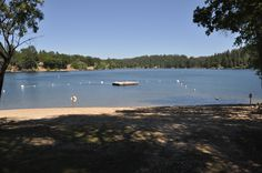 The dock at Pine Mountain Lakes Dunn Court beach (located in #Groveland, CA 95321 & just 26-miles to the N. entrance of #Yosemite National Park) is the smallest and quietest of the three sandy beaches in Pine Mountain Lake.   #LAKEFRONT vacation rental MOUNTAIN LAKESIDE RETREAT is just yards away from Dunn Court Beach. Mountain Lakeside Retreat master calendar: http://www.yosemiteregionresorts.com/48198.htm
