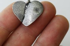 Pendant made out of fingerprints - what a great gift for mom (ahem, me!).