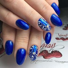 It's bright and memorable manicure that for sure will decorate nails, even for the most noble ladies. The main varnish – is bright blue, with a beautiful g