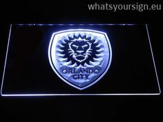 Orlando  City SC - Neon sign LED display made of the best-quality clear acrylic and bright colorful LED glow. The neon sign displays exactly the same from all angles thanks to the carving with the newest 3D laser engraving technology. This LED neon sign is a great gift idea! The neon is provided with a metal chain for displaying. Available in 3 sizes in following colours: Yellow, Green, Purple, Blue, Red, Orange and White!
