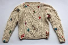 Bridget Harvey's jumper: visible mends act as a multitude of decorative medals after doing battle with consumerism and the marketing machine that fashion presents us with