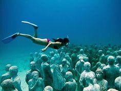 Snorkeler at the underwater museum in Isla Mujeres.