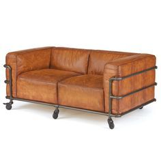 Add unique industrial style to your home with the Hip Vintage Bentley Sofa. This sofa features a simple design with rich, light brown leather upholstery encased in an iron pipe frame with caster wheels.