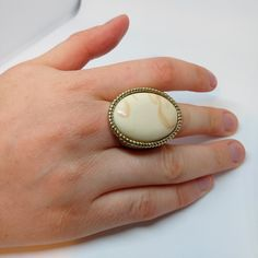 Vintage Cocktail Ring, Statement Ring, Goldtone, Cream Stone.  Excellent condition, with minimal signs of wear, as seen in photos.  Diameter 17mm (UK size N).  *We aim to sell items in the best possible condition, however most of our stock is vintage and therefore secondhand and may have some signs of wear. Any major flaws will be noted in description and highlighted in photos to the best of our ability*