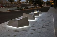 Roc planter illuminated in Barcelona's night.