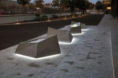Roc planter illuminated in Barcelona's night.