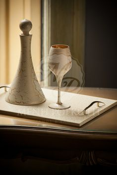 Exquisite set of three pieces, glass, decanter and tray ivory paint with crackeled processing in gold finishing.