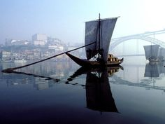 """Douro River, Porto #Portugal The """"Rabelo boats"""" that used to bring the #Port wine from the vineyards to town"""