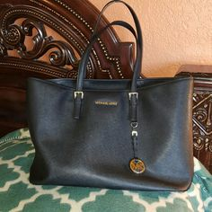 Authentic  Michael  Kors  tote Great shape. Used less than 5 times. Has the zipper center compartment.  Large enough  to store laptop plus some. Pictured with my 10 inch tablet ( not included lol  ) retail 498 Michael Kors Bags Totes
