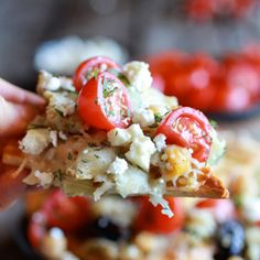 Greek Nachos. Olives, tomatoes, feta. How can you go wrong?