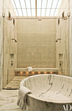 Liberal use of marble lends elegance to the master bath, where Buchanan opened up the ceiling to bring daylight in from above   archdigest.com Tap the link now to see where the world's leading interior designers purchase their beautifully crafted, hand picked kitchen, bath and bar and prep faucets to outfit their unique designs.