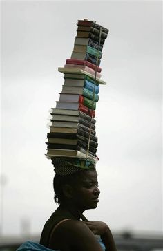 "bookfinda:   Photo from Angola ""Woman carrying books"". Wow! How many books can you carry at once?"