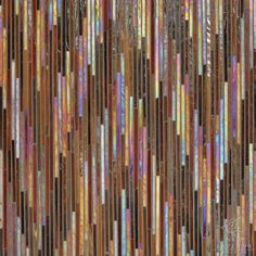 Pamir, a jewel glass mosaic shown in Carnelian and Tortoise Shell, is part of the Ikat Collection by New Ravenna Mosaics.