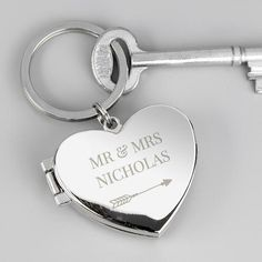 Order Engraved Silver Locket Keyring Swirls for just from The Engraved Gifts Company. Our Engraved Silver Locket Keyring Swirls also comes with free personalisation options. Personalised Pens, Personalized Valentine's Day Gifts, Engraved Gifts, Photo Keyrings, Heart Keyring, Heart With Arrow, Silver Lockets, Anniversary Photos, Photo Heart