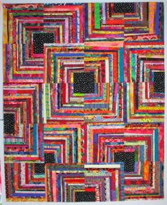 Exuberant Color: Quilts pieced with uneven width strips. Quarter log cabin blocks.