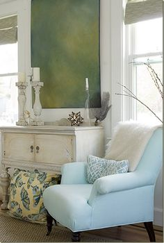 Loving the blue chair....such a lovely shade, and love the white console table beside it!.