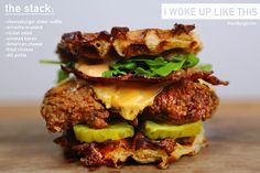 Crispy fried chicken… Cheeseburger waffles…I woke up like this burger by PornBurger.me - cheese waffles, sriracha mustard, rocket salad, smoked bacon, american cheese, fried chicken, dill pickle.