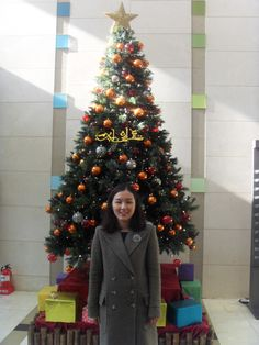 After the church service in front of the church Christmas tree in the building.
