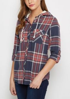 We're mad for plaid! And even more crazy about this extra cozy flannel, featuring a classic plaid pattern with the addition of a mock Sherpa lined hood.