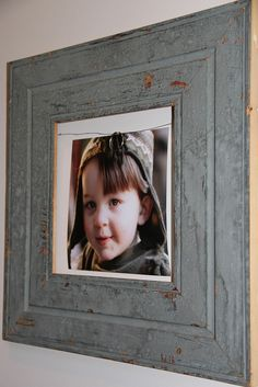 Picture hanging idea by Unskinny Boppy - salvaged wood frame from Southern Accents Architectural Antiques