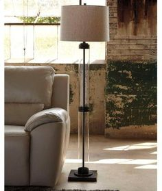 Clearly for those with an eye for hip design. Inspired by the modern industrial look that puts internal workings on display; Louella floor lamp illuminates your space in a cool, minimalistic way. Baroque Furniture, Glass Floor Lamp, Farmhouse Furniture, Modern Industrial, Lighting Design, Lighting Ideas, Home Art, Table Settings, Table Lamp