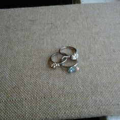 Stackable Trio Rings New, never worn. Crystals, faux pearls, blue flower desing. Size 7. Unsure Jewelry