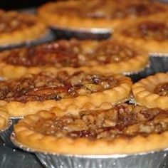 Butter, sugar, cream, raisins, and walnuts fill these traditional butter tarts. Old family recipe from my daughter-in-laws family in southern Mississippi. It is very good. Tart Recipes, Baking Recipes, Dessert Recipes, Baking Desserts, Pastry Recipes, Healthy Desserts, Butter Tart Squares, Canadian Butter Tarts, Butter Pecan Tarts