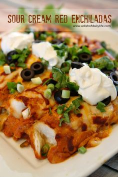 These easy cheesy sour cream red enchiladas are sure to be a hit for Mexican night!