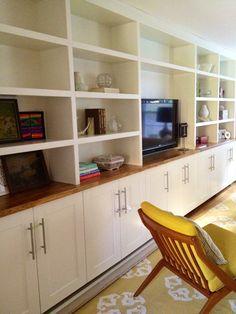 Built-ins. Ikea Adel cabinets below, custom shelving on top. With Ikea butcher block countertop.