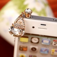 A small bag with nearly transparent crystal is more than enough to draw your attention. Furthermore numerous tiny stones attached at the upper portion of the bag will surely make you cry to purchase this model.  Find more cute headphone jack plugs from www.iphonejackplug.com