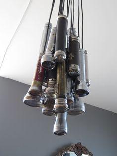 Hang old flashlights as lighting fixture