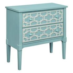 """Wood chest with a lattice motif and tapered legs.   Product: ChestConstruction Material: WoodColor: Shore blue and whiteFeatures: Hand-painted lattice motifDimensions: 27"""" H x 16"""" W x 12"""" D"""