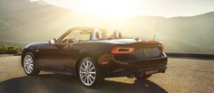 A 2017 FIAT 124 Spider parked in the setting sun