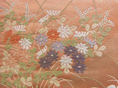Embroidery details. Fukuro obi with chrysanthemum (kiku), nadeshiko, and wisteria motifs.